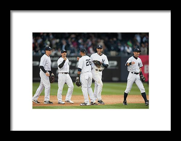 East Framed Print featuring the photograph Baltimore Orioles V. New York Yankees 13 by Rob Tringali