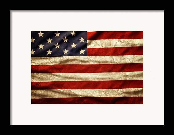 Wrinkled Framed Print featuring the photograph American Flag by Les Cunliffe