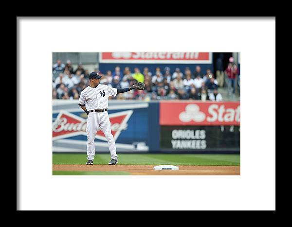 East Framed Print featuring the photograph Baltimore Orioles V. New York Yankees 17 by Rob Tringali