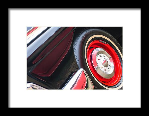 1957 Ford Fairlane Convertible Wheel Emblem Framed Print featuring the photograph 1957 Ford Fairlane Convertible Wheel Emblem by Jill Reger
