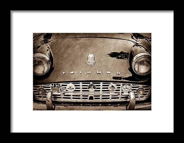 1960 Triumph Tr 3 Grille Emblems Framed Print featuring the photograph 1960 Triumph Tr 3 Grille Emblems by Jill Reger