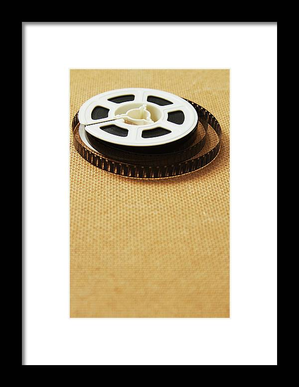 The Media Framed Print featuring the photograph A Reel, Or Spool, Of 8mm Movie Film by Jon Schulte