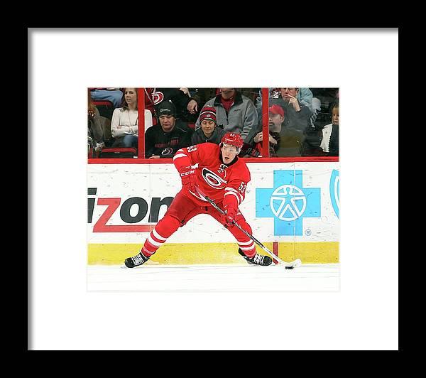 North Carolina Framed Print featuring the photograph Anaheim Ducks V Carolina Hurricanes by Gregg Forwerck