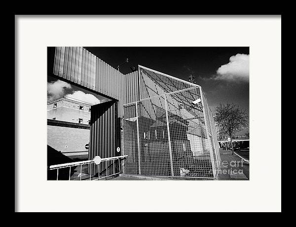 North Framed Print featuring the photograph anti rpg cage surrounding observation sanger at North Queen Street PSNI police station Belfast North by Joe Fox