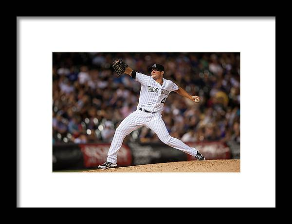 Baseball Pitcher Framed Print featuring the photograph Arizona Diamondbacks V Colorado Rockies by Dustin Bradford