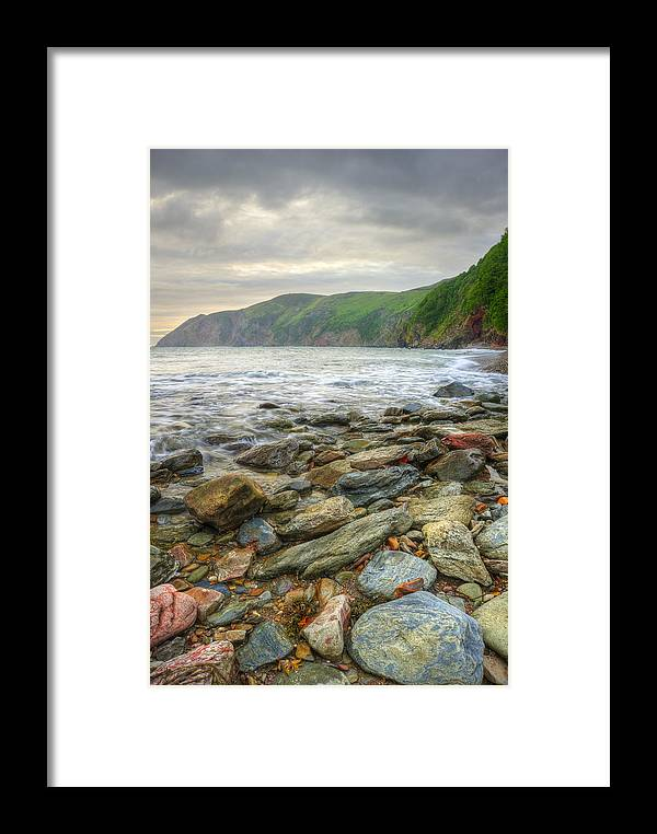 Landscape Framed Print featuring the photograph Beautiful Warm Vibrant Sunrise Over Ocean With Cliffs And Rocks by Matthew Gibson