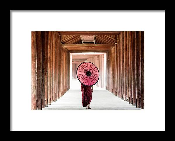 Adolescence Framed Print featuring the photograph Buddhist Monk Walking Along Temple by Martin Puddy