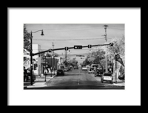 Chaplin Framed Print featuring the photograph chaplin street main street through swift current Saskatchewan Canada by Joe Fox
