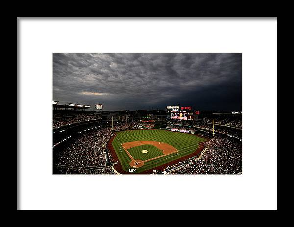 American League Baseball Framed Print featuring the photograph Cincinnati Reds V Washington Nationals by Patrick Smith