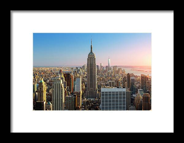 Tranquility Framed Print featuring the photograph Empire State Building At Sunset by Sylvain Sonnet