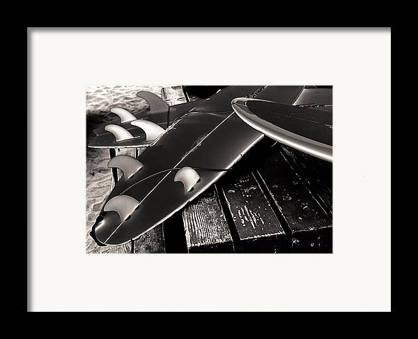 Fins And Boards Framed Print featuring the photograph Fins And Boards by Ron Regalado