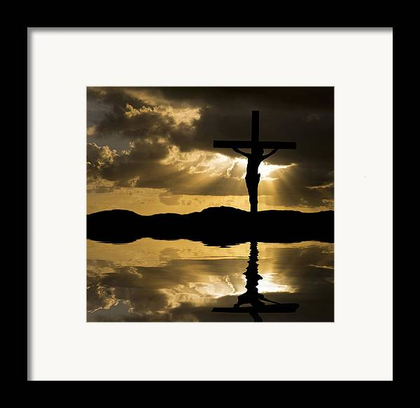 Jesus Framed Print featuring the photograph Jesus Christ Crucifixion On Good Friday Silhouette Reflected In by Matthew Gibson