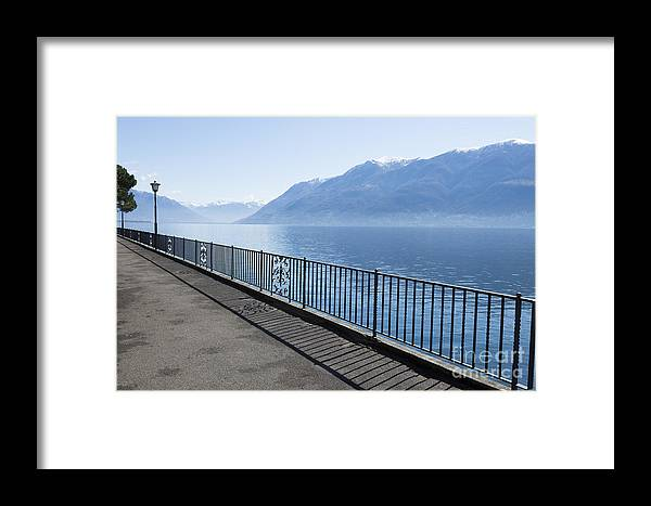 Fence Framed Print featuring the photograph Lakeside by Mats Silvan