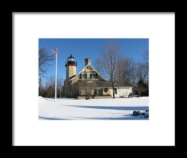 Winter Framed Print featuring the photograph Mcgulpin Point Lighthouse In Winter by Keith Stokes
