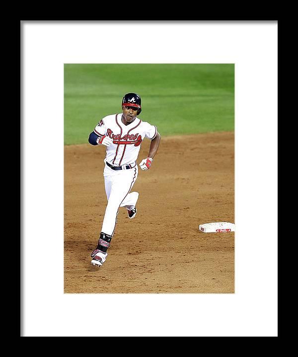 Atlanta Framed Print featuring the photograph Milwaukee Brewers V Atlanta Braves by Mike Zarrilli