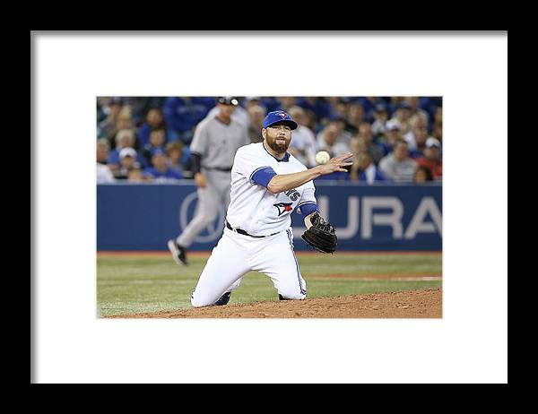 American League Baseball Framed Print featuring the photograph New York Yankees V Toronto Blue Jays by Tom Szczerbowski