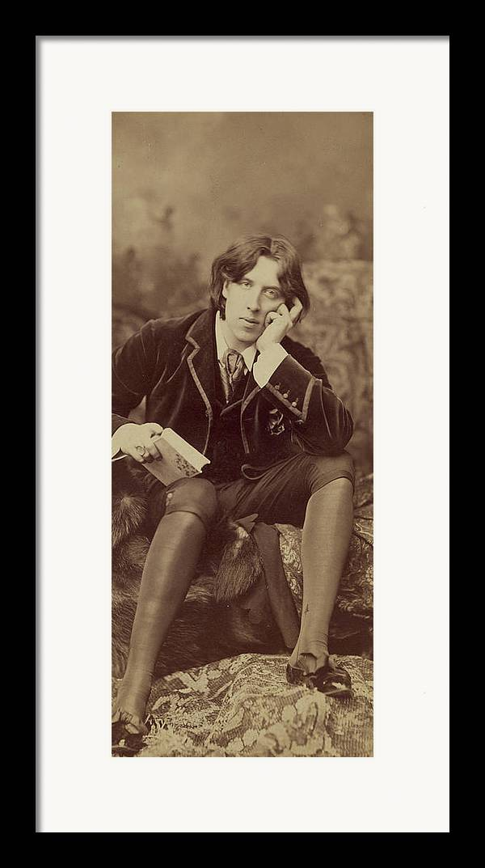 Oscar; Wilde; Irish; Writer; Poet; Author; Dandy; Photograph; Sepia; Black; White; Velvet; Smoking; Jacket; Breeches; Wearing; Stockings; Full; Length; Seated; Oscar Wilde Framed Print featuring the photograph Oscar Wilde 1882 by Napoleon Sarony