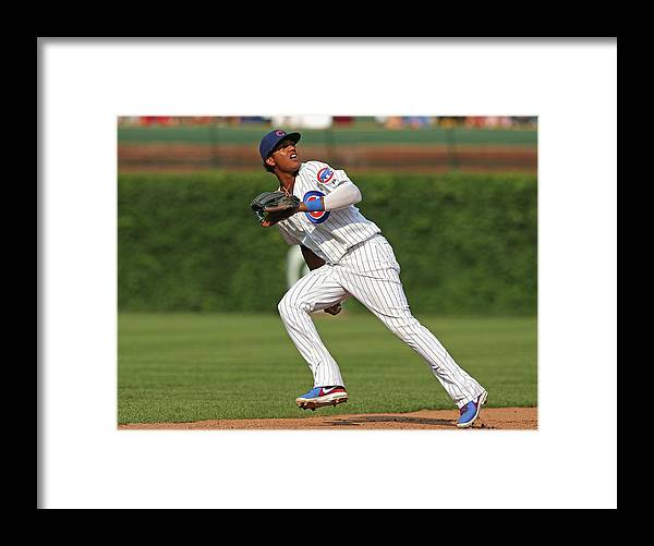 Following Framed Print featuring the photograph Pittsburgh Pirates V Chicago Cubs by Jonathan Daniel