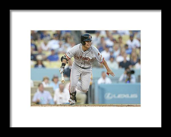 People Framed Print featuring the photograph San Francisco Giants V Los Angeles by Stephen Dunn