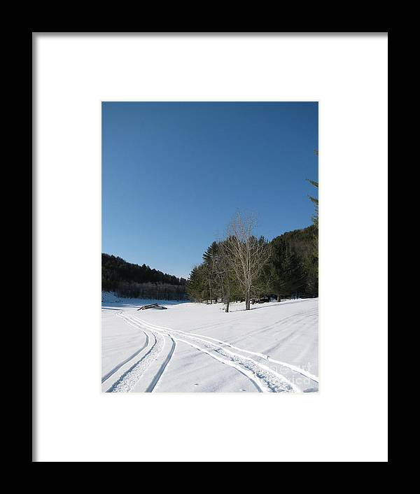 Snow Framed Print featuring the photograph Snowmobile Tracks by Nancie Johnson