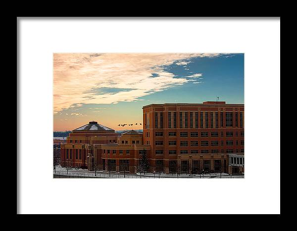 Rochester Minnesota Geese Goose Bird Fowl Water Waterfowl Winter Snow Orange Red Yellow Blue White Sky Winter Scenic City Architecture Fly Flight Cloud Sun Sunrise Photographs Framed Print featuring the photograph Sunrise Flyby by Tom Gort
