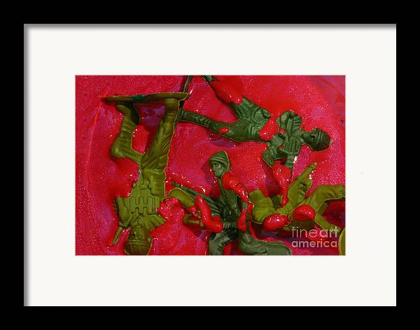 Aggression Framed Print featuring the photograph Toy Soldiers In A Pool Of Blood by Amy Cicconi