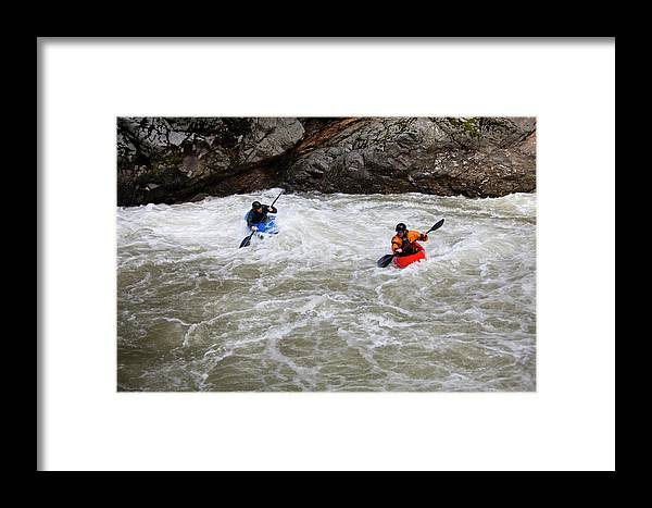 Adult Framed Print featuring the photograph Two Kayakers Carry Their Boats by Michael Hanson