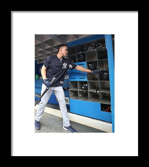 Headwear Framed Print featuring the photograph New York Yankees v Toronto Blue Jays by Tom Szczerbowski
