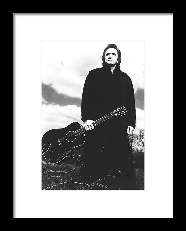 classic Framed Print featuring the photograph Johnny Cash by Retro Images Archive