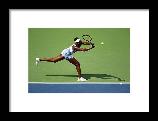 Monica Puig Framed Print featuring the photograph 2015 U.s. Open - Day 1 by Clive Brunskill