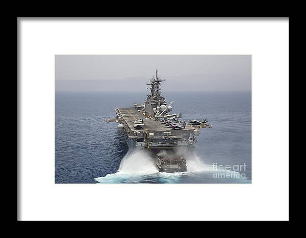 Military Framed Print featuring the photograph A Landing Craft Air Cushion Enters by Stocktrek Images
