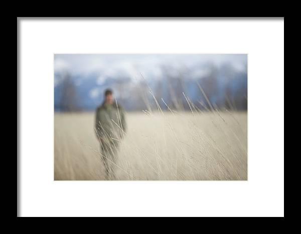 Adult Framed Print featuring the photograph A Young Man Enjoys A Winter Stroll by Heath Korvola