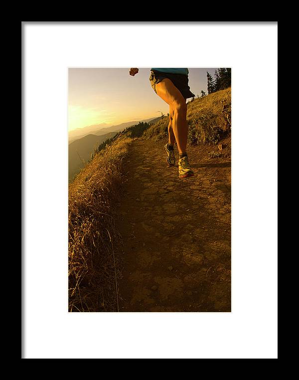 40-44 Years Framed Print featuring the photograph A Young Woman Runs Along The Dog by Jeff Diener