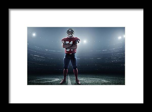 Soccer Uniform Framed Print featuring the photograph American Football In Action by Dmytro Aksonov