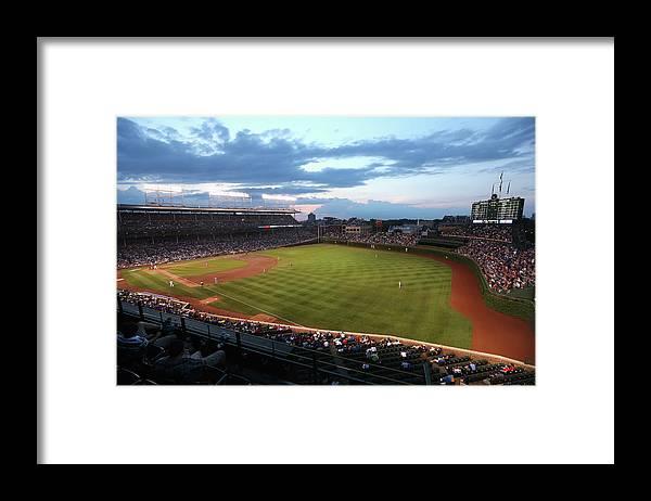 National League Baseball Framed Print featuring the photograph Cincinnati Reds V Chicago Cubs by Jonathan Daniel