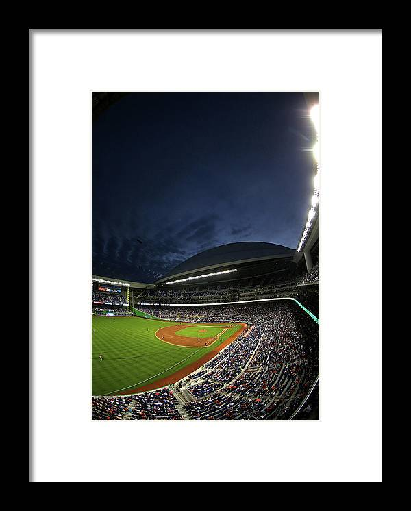 American League Baseball Framed Print featuring the photograph Colorado Rockies V Miami Marlins by Mike Ehrmann