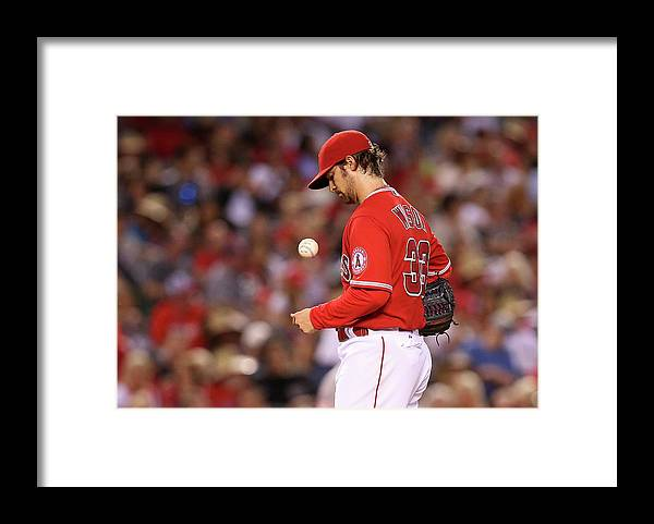 Three Quarter Length Framed Print featuring the photograph Houston Astros V Los Angeles Angels Of by Stephen Dunn
