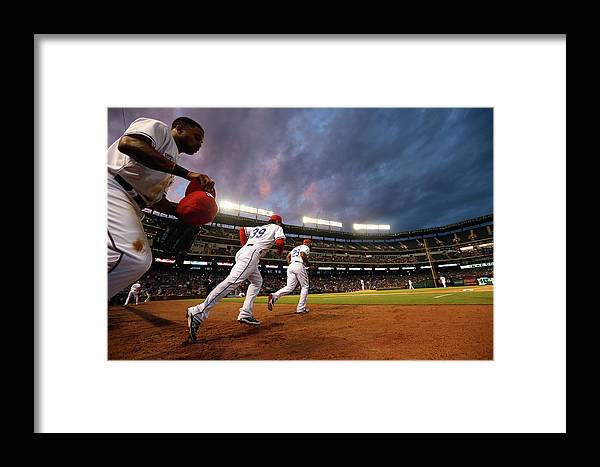 American League Baseball Framed Print featuring the photograph Kansas City Royals V Texas Rangers by Ronald Martinez