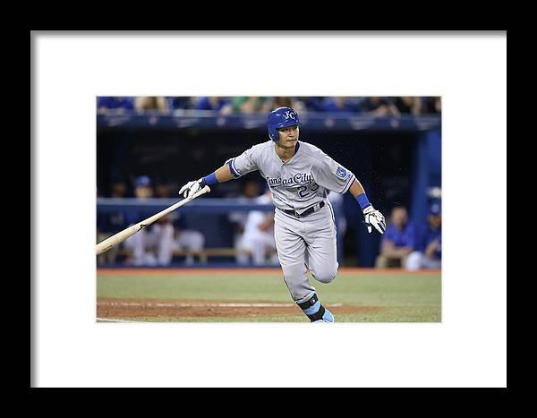 American League Baseball Framed Print featuring the photograph Kansas City Royals V Toronto Blue Jays by Tom Szczerbowski