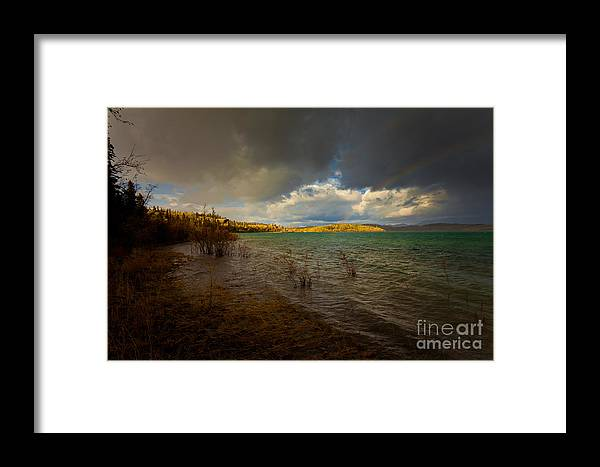 Adventure Framed Print featuring the photograph Rainbow And Dark Clouds Over Large Lake by Stephan Pietzko