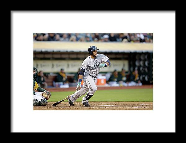 American League Baseball Framed Print featuring the photograph Seattle Mariners V Oakland Athletics by Ezra Shaw