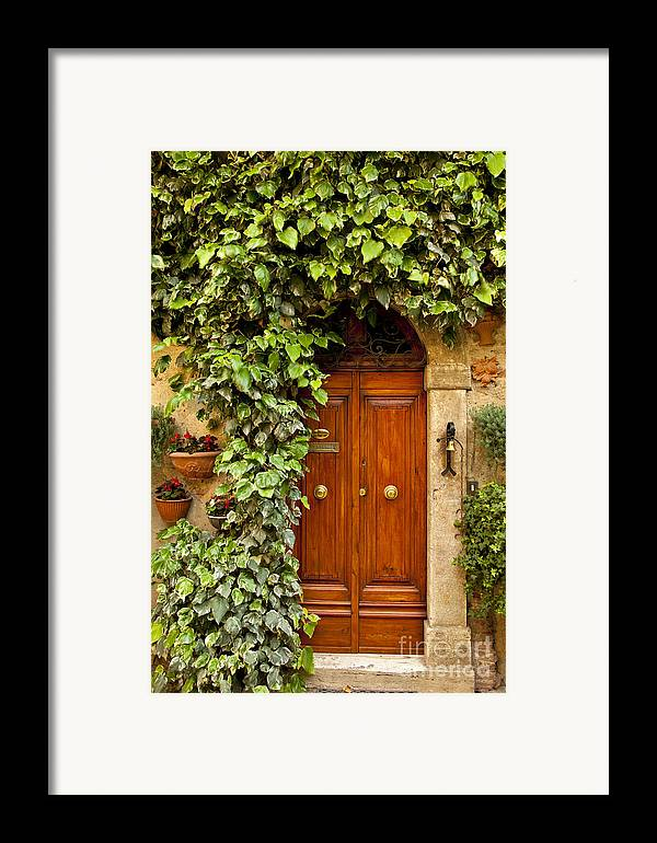 Arch Framed Print featuring the photograph Tuscan Door by Brian Jannsen
