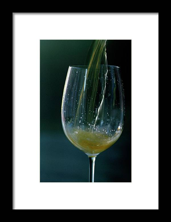 Beverage Framed Print featuring the photograph A Glass Of Beer by Romulo Yanes