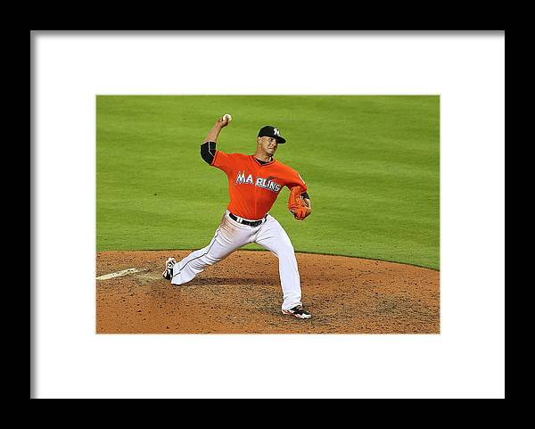 People Framed Print featuring the photograph Colorado Rockies V Miami Marlins by Mike Ehrmann