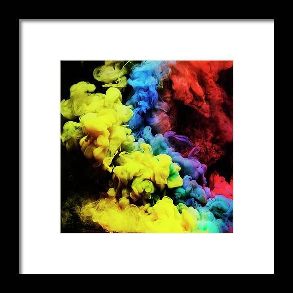 Copenhagen Framed Print featuring the photograph Coloured Smoke Mixing In Dark Room by Henrik Sorensen