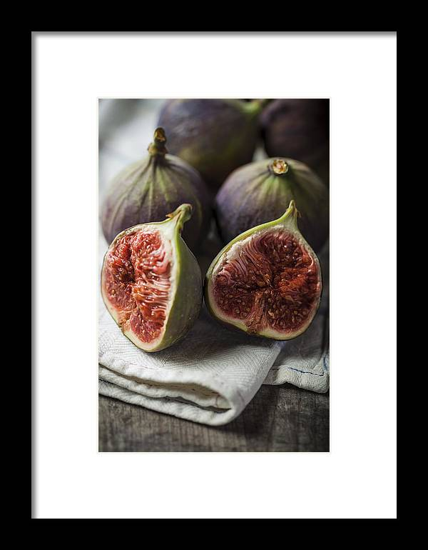 Fig Framed Print featuring the photograph Delicious Figs On Wooden Background by Daniel Barbalata
