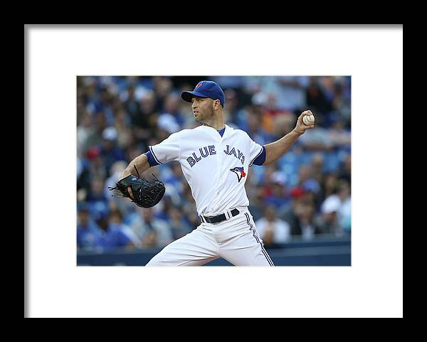 American League Baseball Framed Print featuring the photograph Kansas City Royals V Toronto Blue Jays by Tom Szczerbowski
