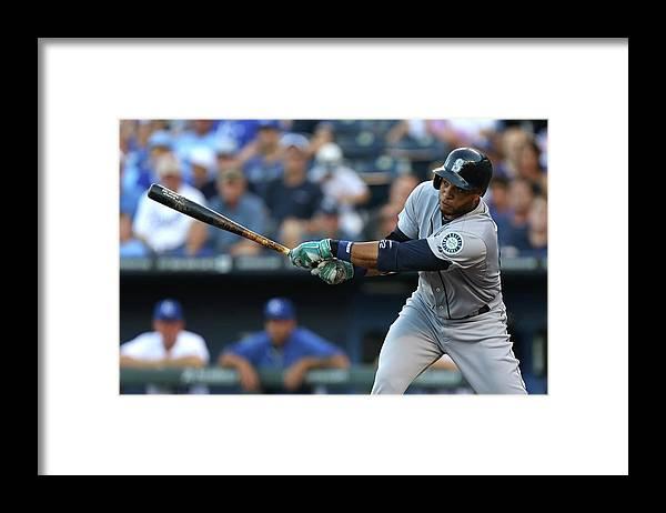 American League Baseball Framed Print featuring the photograph Seattle Mariners V Kansas City Royals by Ed Zurga