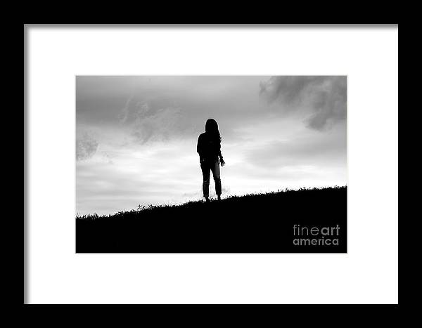 Nancy Lin Framed Print featuring the photograph Silhouette Of Girl Against Overcast Sky by Jannis Werner