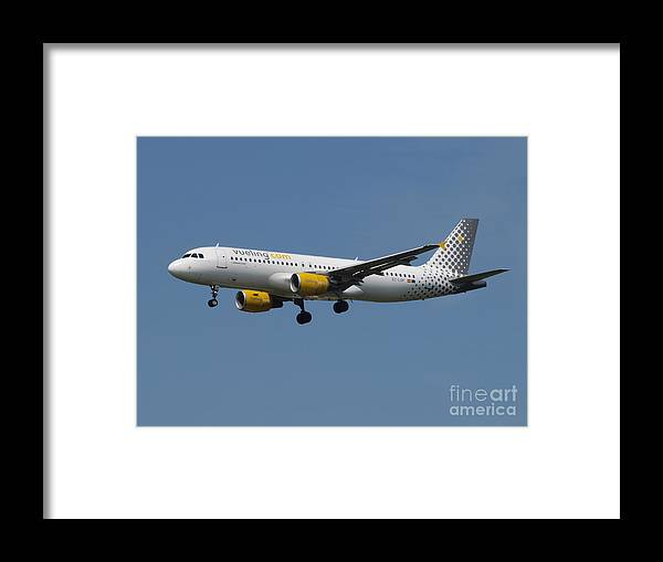 737 Framed Print featuring the photograph Vueling Airbus A320 by Paul Fearn